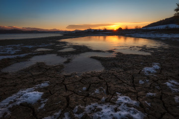 Crevices in the frozen mud in a cold morning