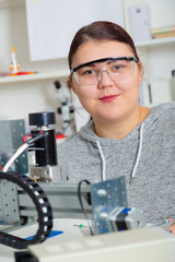 Female Apprentice working  on CNC machinery.