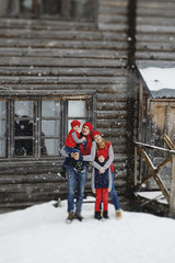 Mother, father and two sons having fun in snow winter