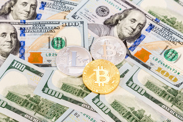 Coins of cryptocurrency on the american dollars banknotes. Business concept of worldwide cryptocurrency