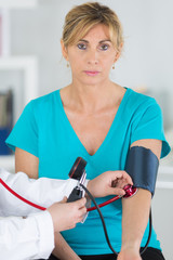 Middle aged lady having blood pressure test