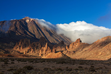 Teide volcano mountain in clouds on sunset in Taide park, Tenerife, Canary Islans, Spain