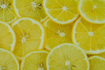 Cutted lemons background. Top view. Citrus fruit lemon