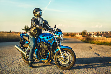 Man on sport motorcycle outdoor on the road