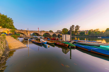 Boats and richmond bridge at dusk