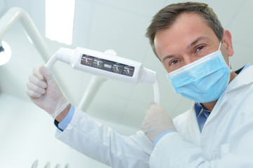 portrait of male dentist in surgical mask