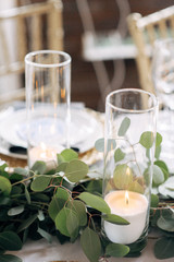 Decorated area with white candle and flowers on the table