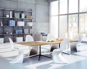 Tischgruppe mit weißen Stühlen in stylishem Loft