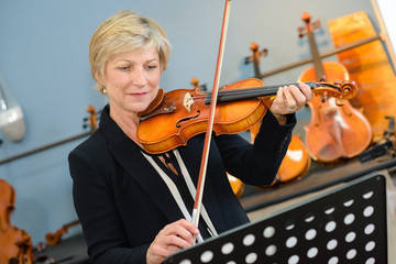 Mature lady playing violin