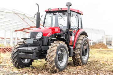 Equipment for agriculture, machines  presented to an agricultural exhibition.  Tractors outdoors