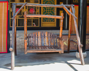 Antique red pine swing