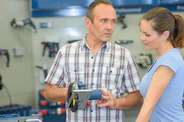 customer in hardware store buying sander