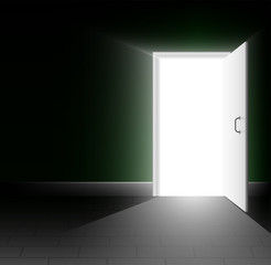 An open door in a dark room. A ray of light shines into the darkness. A bright way out. Copy space.