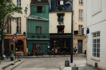 Typical view of the Parisian street with tables of cafe in Paris, France.