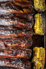 smoked beef spareribs with bbq and corn top view