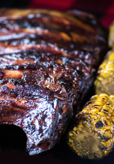smoked rack of beef spareribs with bbq and corn