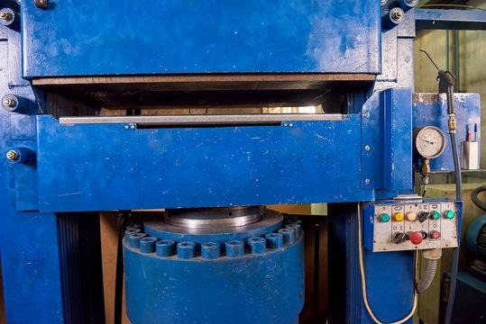 Hydraulic press machine. Factory equipment, control panel. Evolution of hydraulics.