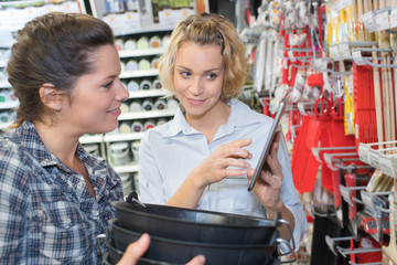 friends buying at home hardware and furniture store