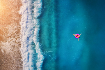 Aerial view of young woman swimming in the sea Fototapete