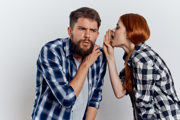 young woman, man with a beard, secret, emotion, couple, light background