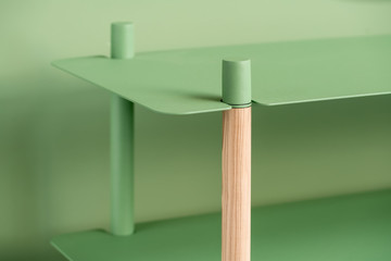 Metal green stand with wooden part