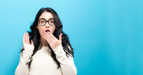 Surprised young woman posing on a solid background