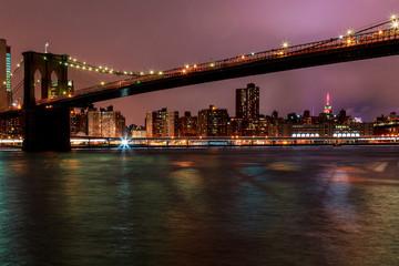 Brooklyn Bridge at dusk viewed from the Brooklyn Bridge Park New York City.