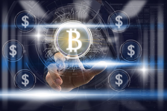 Businessman Finger touching the bitcoin icon over the currency dollar icon and light from blurred server room background, Fintech and AI concept
