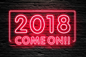 READY FOR 2018 NEW YEAR concept. 2018 COME ON text fluorescent Neon tube Sign on dark brick wall. Front view. Can be used for online banner ads or background. night moment.