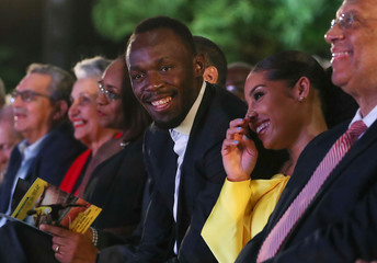 Olympic champion Bolt and his girlfriend attend a ceremony for the unveiling of Bolt's statue at the Statue Park at the National Stadium, in Kingston