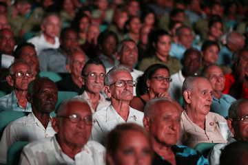 People watch an event held in commemoration of the first anniversary of interment of late Cuba's President Fidel Castro's ashes in Santiago