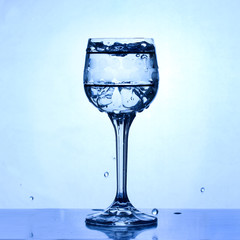 vintage glass with ice and liquid