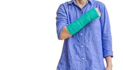 worker woman accident on arm with green cast isolated on white