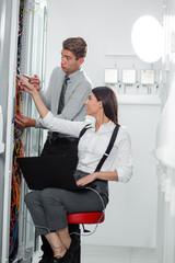 team of busienss people working in server room