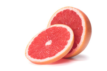 cut citrus fruit, red grapefruit, isolated with shadow on white