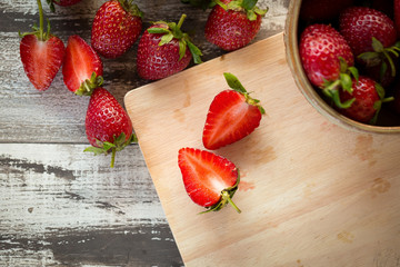 Strawberry In a bowl On a Wooden Background
