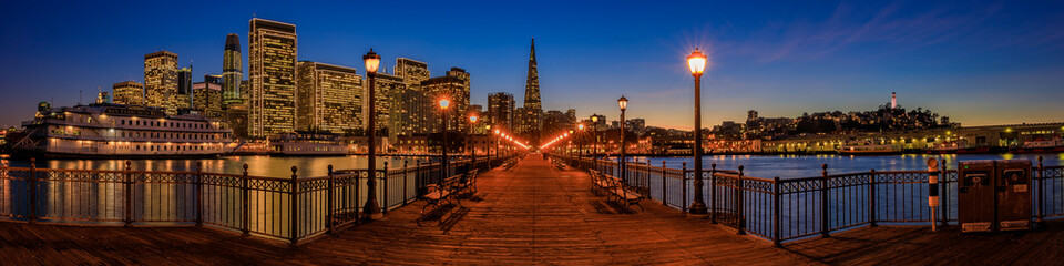 Downtown San Francisco and the Transamerica Pyramid at Chrismas from wooden Pier 7 at sunset