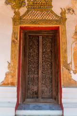 Ancient carved old wooden door in Wat Kong Kha Ram temple more than 200 years old preserved the history of  Photharam district Rachaburi province Thailand.