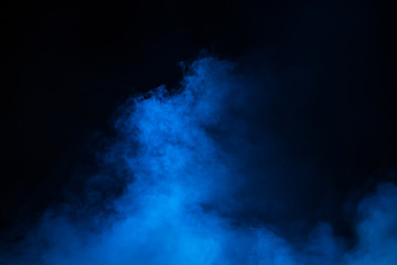 Blue theatrical smoke on stage during a performance or show.
