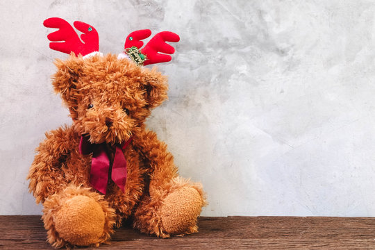 Teddy Bear  put on the Headband for Christmas on brick background