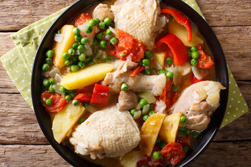 Filipino Afritada: slices of chicken with vegetables close-up in a bowl. horizontal top view