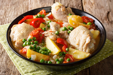 Chicken meat stewed with vegetables and spices close-up in a bowl. horizontal