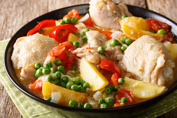 Filipino Afritada: slices of chicken with vegetables close-up in a bowl. horizontal