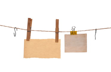 Old paper, blank card hanging on string with clothespin, isolated on white