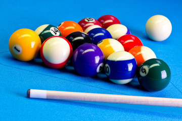 Billiard pool game eight ball setup with cue on billiard table