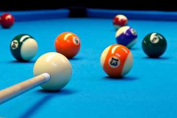 Billiard pool eightball taking the shot on billiard table