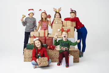 Children and stack of christmas present