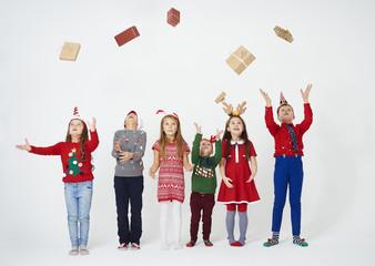 Cheerful children throwing their gift