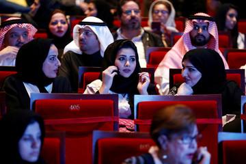 Saudi people watch the concert for composer Yanni during the concert at Princess Nourah bint Abdulrahman University in Riyadh