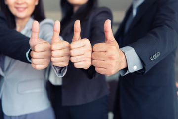 Business team are giving thumbs up of achievement project, Business concept